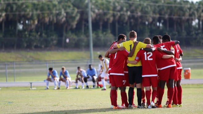 The SW Florida Adrenaline huddles before its game against Floridians FC at Estero High School on May 18, 2016. (Kelli Krebs, Staff)