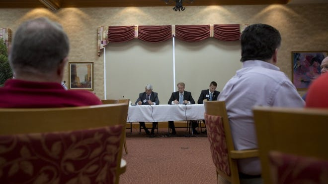 Candidates Burt Saunders, left, Russell Tuff, center, and Ron Kezeske, right, of District 3 speak during a Republican forum for Commission in Naples on June 3, 2016. (Erica Brechtelsbauer/Staff)