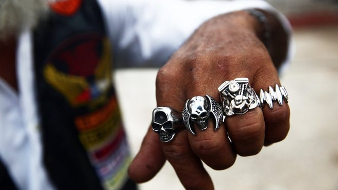 Jose Salgado of Havana, Cuba, a harlista, or Harley-Davidson biker, shows his collection of motorcyclist rings during an Association of Latin American Motorcyclists chapter meeting in Havana, Cuba on Saturday, March 26, 2016. Some harlistas are members of the Association of Latin American Motorcyclists chapter in Cuba. (Dorothy Edwards/Staff)