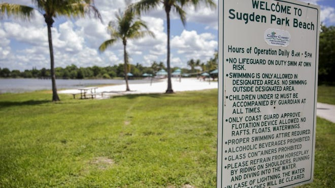 A welcome sign at Sugden Park Beach lists the rules for visitors in Naples, Florida. (Nicole Raucheisen/Staff)