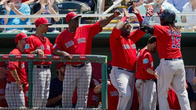 The Boston Red Sox dugout congratulates infielder hanley Ramirez after Ramirez hit a home run against the Minnesota Twins during a spring training game at Hammond Stadium in Fort Myers Thursday, March 31, 2016. The Twins would win 7-4 in their last home spring training game. (Luke Franke/Staff)
