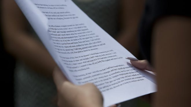 "A woman reads from the Stanford Sexual Assault victim's letter at the Stanford Rape Protest at Mercato on Saturday, June 11, 2016 in Naples, Florida. The group ""20 Minutes of Action for Emily Doe"" travelled to several locations throughout Naples to take turns reading the letter to raise awareness about the Stanford case."