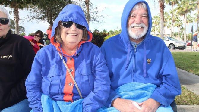 Betty & Andy Kidd stay warm despite a chilly breeze.