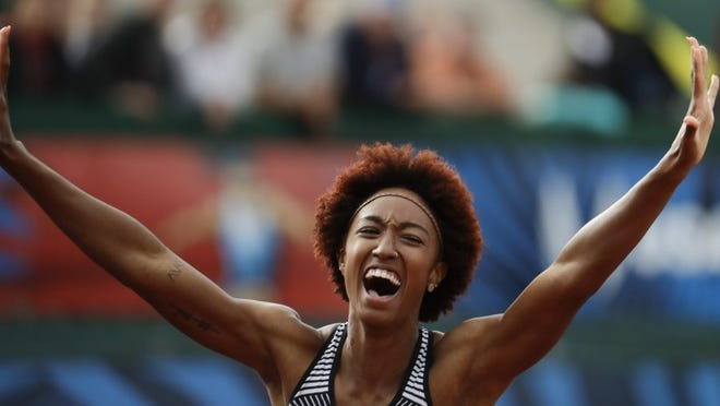 AP photo Brianna Rollins celebrates her win in the women's 100-meter hurdles final at the U.S. Olympic Track and Field Trials on Friday, in Eugene Ore.