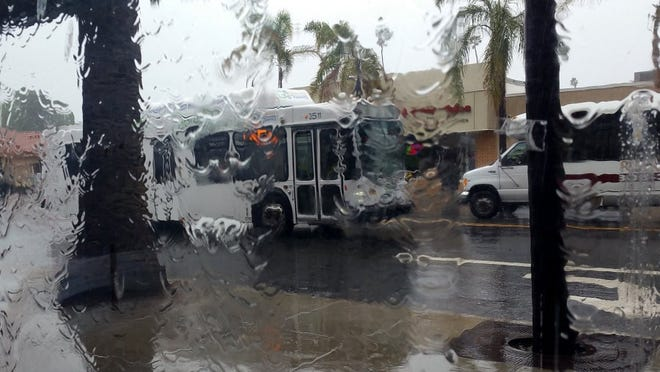 Rain fall in downtown Oxnard in March 2016.