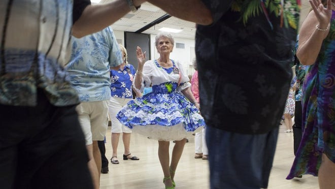 TROY HARVEY/SPECIAL TO THE STAR Diane Schreiber spins around the dance floor during the annual Sea Breeze Dance at the Goebel Adult Community Center in Thousand Oaks on Sunday.