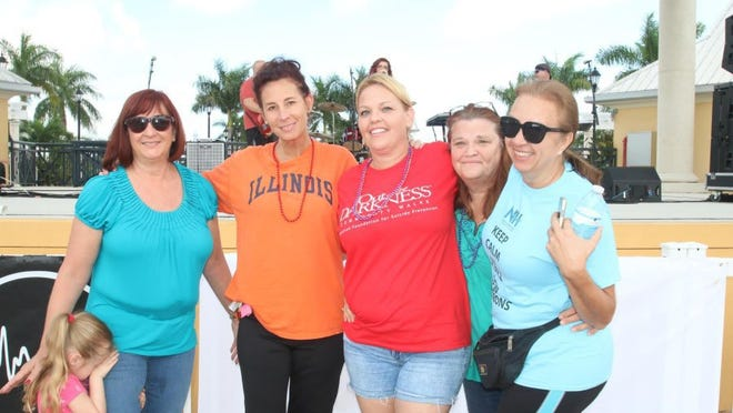TCPALM.COM Christine Iannotti, in red shirt, was a key organizer of the St. Lucie County Out of the Darkness Walk.