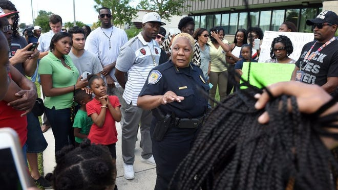 Fort Pierce Police Chief Diane Hobley-Burney addresses a crowd of people gathered in front of the Fort Pierce Police Department on April 26, in response to the fatal shooting of Demarcus Semer, 21, by a Fort Pierce police officer on April 23 in Fort Pierce. (FILE PHOTO)