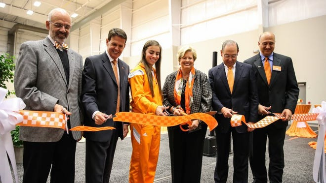 From left, Tennessee president Dr. Joe DiPietro, athletic director Dave Hart, volleyball captain Megan Hatcher, former women's AD Joan Cronan, chancellor Jimmy Cheek and Lady Vols coach Rob Patrick do the official ribbon cutting for the Joan Cronan Volleyball Center on Friday.