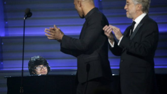 Young jazz piano prodigy Joey Alexander — at last month's Grammy Awards with Common and Neil Portnow — will perform Feb. 11, 2017, at GPAC. (Robert Gauthier/Los Angeles Times)