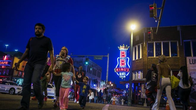 April 16, 2016 — Beale St. is a prime destination for visitors looking to eat food and listen to Blues music in Memphis. (Yalonda M. James/The Commercial Appeal)