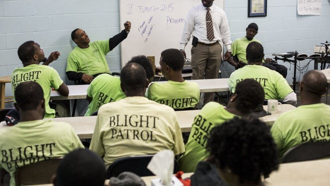 May 18, 2016 - Rev. DeAndre Brown smiles while talking with members of the Blight Patrol before sending them out to help clean the city. The Blight Patrol, a product of Rev. DeAndre Brown's Lifeline to Success re-entry program for ex-offenders, was recognized by City Council this Tuesday when they approved member Joe Brown's motion to double the annual allocation to Lifeline from $100,000 to $200,000. (Brad Vest/The Commercial Appeal)