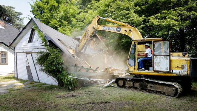June 22, 2016; Don Berryhill uses a backhoe to knock down a blighted abandoned home on Mississippi Boulevard through the Blight Elimination Program. (Mike Brown/The Commercial Appeal)