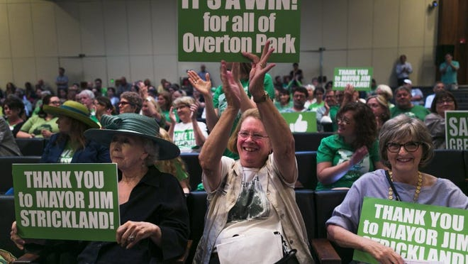 Community activist Mary Wilder claps while sitting next to fellow greensward supporters, former senator Beverly Marrero, left, and Emily Carothers, right, during a Memphis City Council meeting last month. The City Council voted unanimously for a plan to end parking on the Overton Park greensward. The city is now drafting a consent agreement between the Memphis Zoo and the Overton Park Conservancy.