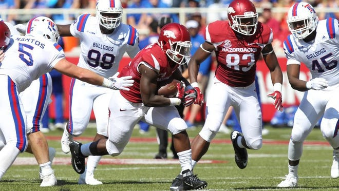 Sep 3, 2016; Fayetteville, AR, USA; Arkansas Razorbacks running back Rawleigh Williams III (22) rushes in the first half against the Louisiana Tech Bulldogs at Donald W. Reynolds Razorback Stadium. Mandatory Credit: Nelson Chenault-USA TODAY Sports