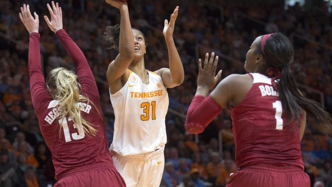 Tennessee's Jaime Nared attempts to score while defended by Alabama's Nikki Hegstetter, left, and Quanetria Bolton at Thompson-Boling Arena on Sunday, January 31, 2016.      (SAUL YOUNG/NEWS SENTINEL)