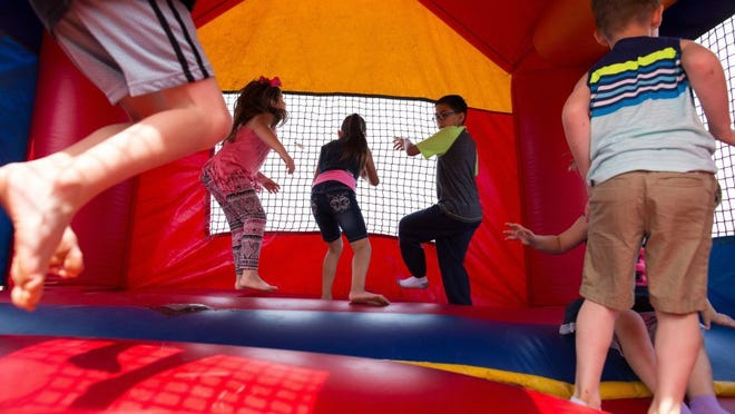 COURTNEY SACCO/CALLER-TIMES Kids play in a bounce house Saturday, March 26, 2016, during the Fellowship of Oso Creek's 16th Annual Easter Festival.