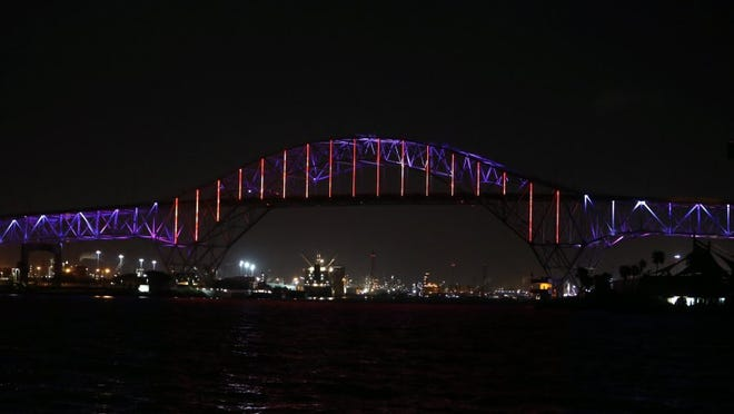 Rachel Denny Clow/Caller-Times The Harbor Bridge glowed red, white and blue on Monday, June 20, 2016 and also included a rainbow in the light show in memory of the victims of the mass shooting in Orlando, Florida.