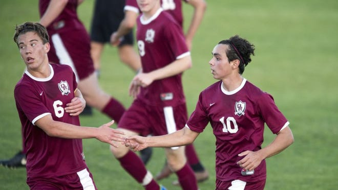 Oak Ridge's Brent Robinson, left, and Matthew Malagon celebrate after Malagon scored against Bearden at Bearden High School on Tuesday, March 29, 2016. (SAUL YOUNG/NEWS SENTINEL)