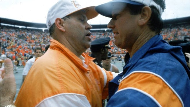 Tennessee coach Phillip Fulmer shares a pat on the back with Florida coach Steve Spurrier on Dec. 20, 1992.