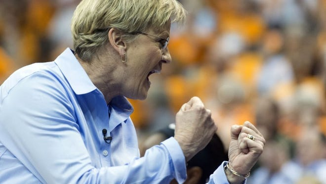 Tennessee coach Holly Warlick celebrates during a game against Arkansas in the SEC Women's Basketball Tournament on March 3 in Jacksonville, Fla.