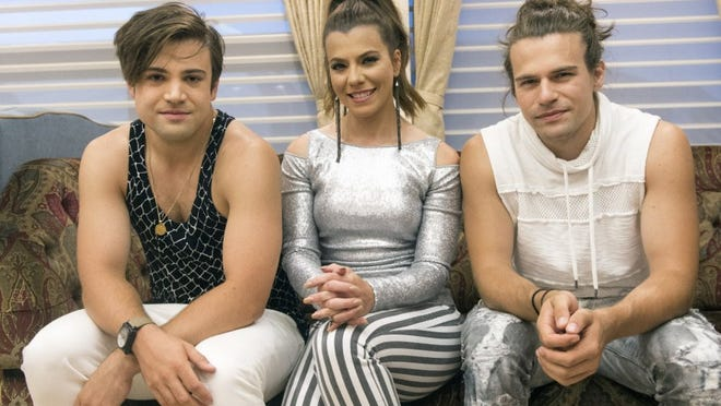 The Band Perry — from left, Neil Perry, Kimberly Perry and Reid Perry — at their tour bus before their show at Bristol Motor Speedway on Friday, September 9, 2016. (SAUL YOUNG/NEWS SENTINEL)
