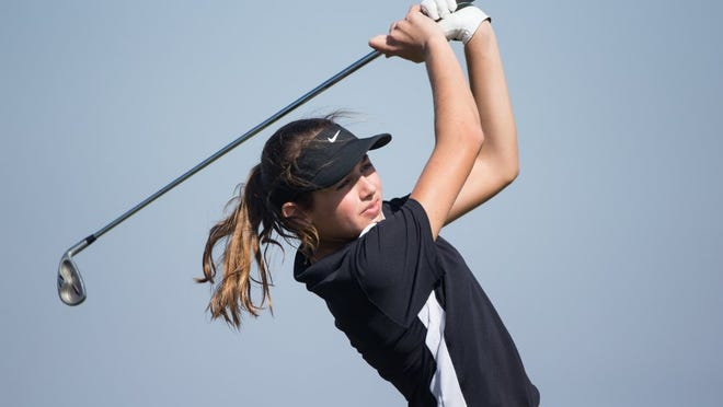Flour Bluff's Katelyn Habib watches her tee shot on the seventh hole at the Calallen Wildcat Invitational on Monday at River Hills Country Club.