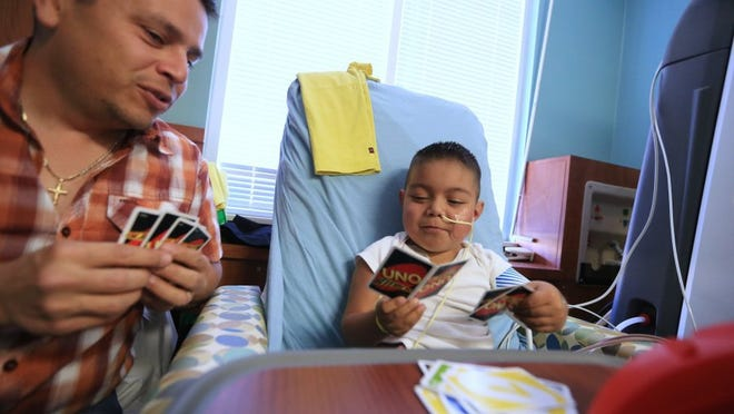Rachel Denny Clow/Caller-Times Mario Cardenas plays Uno with his son, Sebastian, 6, as the receives dialysis treatment Friday, March 4, 2016, at Driscoll Children's Hospital.