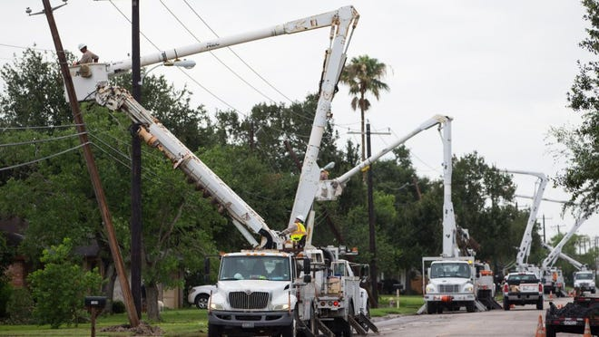 Crews work Wednesday, June 1, 2016, to repair power lines on East Ailsie Avenue in Kingsville following severe weather the night before.