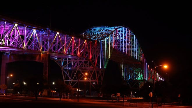 Rachel Denny Clow/Caller-Times The Harbor Bridge glowed red, white and blue on Monday and also included a rainbow in the light show in memory of the victims of the mass shooting in Orlando, Florida.