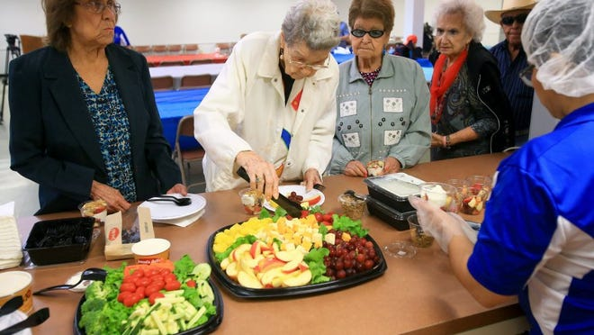 GABE HERNANDEZ/CALLER-TIMES Seniors gather to eat fresh fruit, vegetables and snacks as Reliant Energy and the city open the Beat the Heat Center on Friday, June 24, 2016, at the Lindale Senior Center in Corpus Christi.