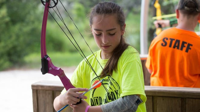 COURTNEY SACCO/CALLER-TIMES Thirteen-year-old Sofia Deluna places an arrow on her bow during the fourth day of Camp Sandcastle, a camp for children with Type 1 diabetes, Thursday, June 30, 2016, at Camp Aranzazu in Rockport.