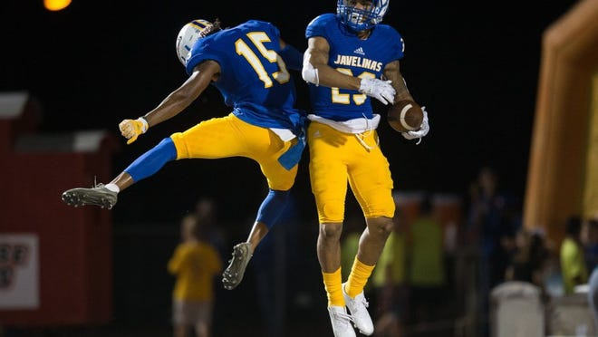 COURTNEY SACCO/CALLER-TIMES Texas A&M-Kingsville's Forrest Jones (right) celebrates with Justin Guillory after scoring on a 27-yard interception return in the third quarter of the Javelinas' 68-7 win Saturday over Simon Fraser.