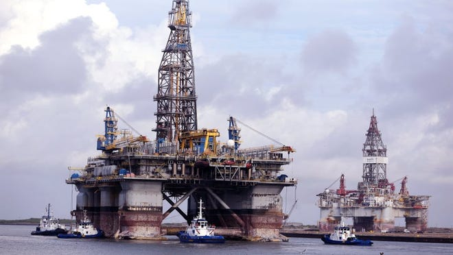 Rachel Denny Clow/Caller-Times The Noble Jim Day, one of the world's largest offshore oil rigs, passes by another docked oil rig in Port Aransas on Thursday.
