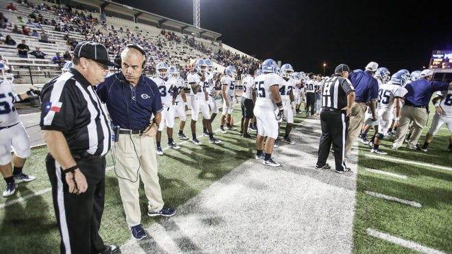 Micah DeBenedetto/Special to the Caller-Times Carroll coach Jerry Long speaks with a referee before the second half against Moody at Buc Stadium on Friday, Sept. 30, 2016.
