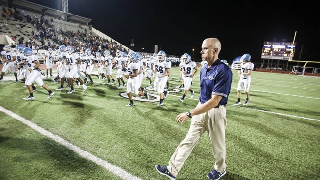 Carroll coach Jerry Long walks on the field as his team enters before the second half against Moody at Buc Stadium on Friday, Sept. 30, 2016.
