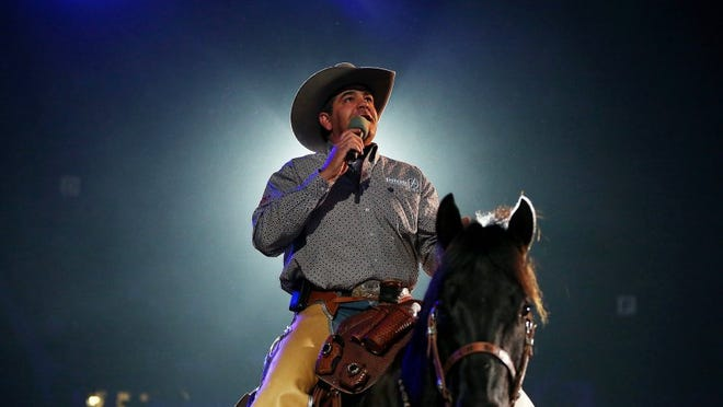 Patrick Dove/Standard-Times file Rodeo announcer Boyd Polhamus introduces himself to the crowd during the first performance of the 2015 San Angelo Stock Show & Rodeo at Foster Communications Coliseum.