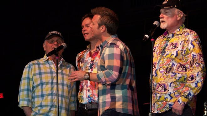 From left: Bruce Johnston, Scott Totten, Brian Eichenberger and Mike Love harmonize on tribute song for Nancy Reagan during a March 6, 2016, concert in Abilene.