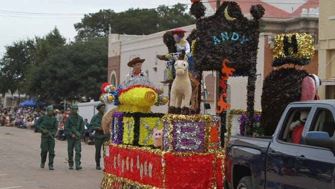 """Times Record News FILE A """"Toy Story""""-themed float from the Henrietta freshman class is driven along the parade route and followed by toy soldiers at the 2015 Clay County Pioneer Reunion parade in downtown Henrietta. This year's Pioneer Reunion kicked off Thursday and continues Friday and Saturday."""
