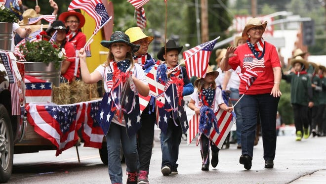 Children from Exodus Farms march down the Redding Rodeo Parade route May 21, 2016.