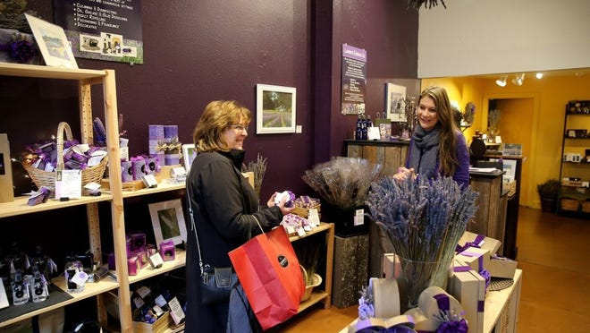 Pelindaba Lavender on Bainbridge Island store manager Deb Craig (right) helps customer Sherry Levers, who is visiting from Dallas. LARRY STEAGALL / KITSAP SUN