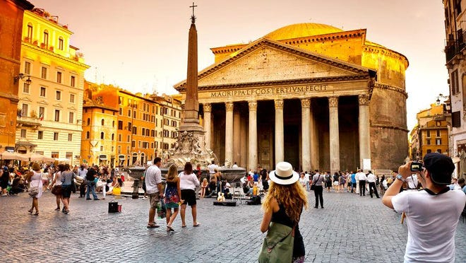 Visitors pose for photos outside of Rome's Pantheon.