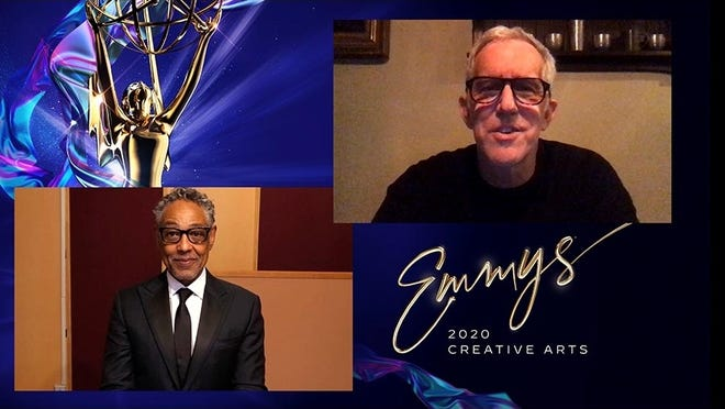 """Cohasset's Bill Henry, right, is shown during the  2020 Creative Arts Emmys. Henry won the Emmy Award for his work on """"Succession."""" At left, is award presenter Giancarlo Esposito."""