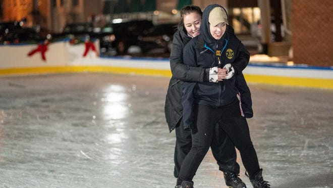 Sam Fortune and Kaillie Hardy skate together on Jan. 14, 2019, at the Adrian Film Community Rink at the corner of Maumee and Winter street. The Adrian City Commission decided the rink will not return this winter.