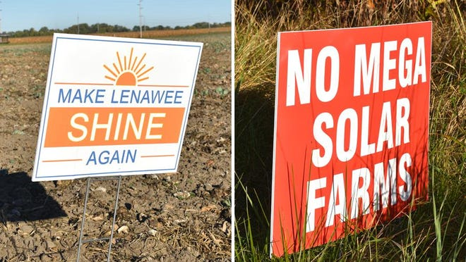 These signs in favor of and against a proposed solar farm in Deerfield and Riga townships are seen Thursday along Carroll Road.