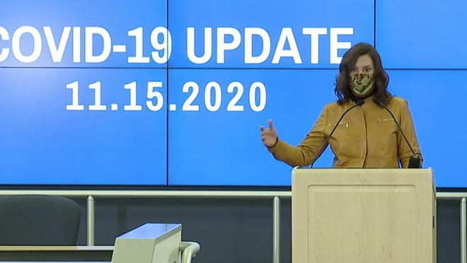 Gov. Gretchen Whitmer speaks Sunday during an announcement of a new emergency order that closes high schools, restaurants and bars to in-person service for three weeks. The order also includes other limitations on indoor gatherings meant to address rising coronavirus cases.