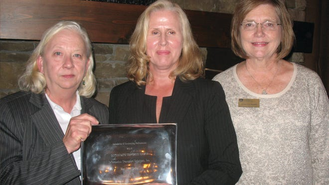 From left, Family Sunshine Center Executive Director Karen Sellers, Information Transport Solutions Founder Tomi Selby and AFP Central Alabama Chapter President Anna Lee Ingalls appear at a ceremony honoring ITS.