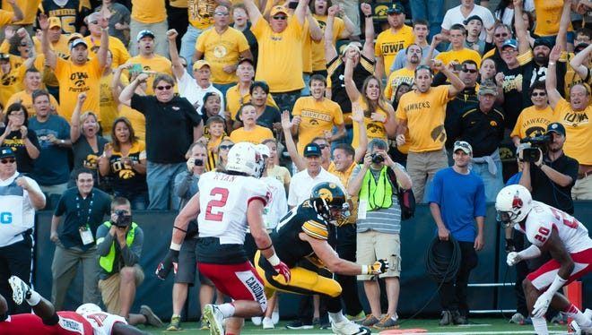 Iowa tight end Jake Duzey scores a touchdown late in last year's Sept. 6 home win against Ball State. The Hawkeyes lost their final two home games last year (to Wisconsin and Nebraska) by a combined five points.