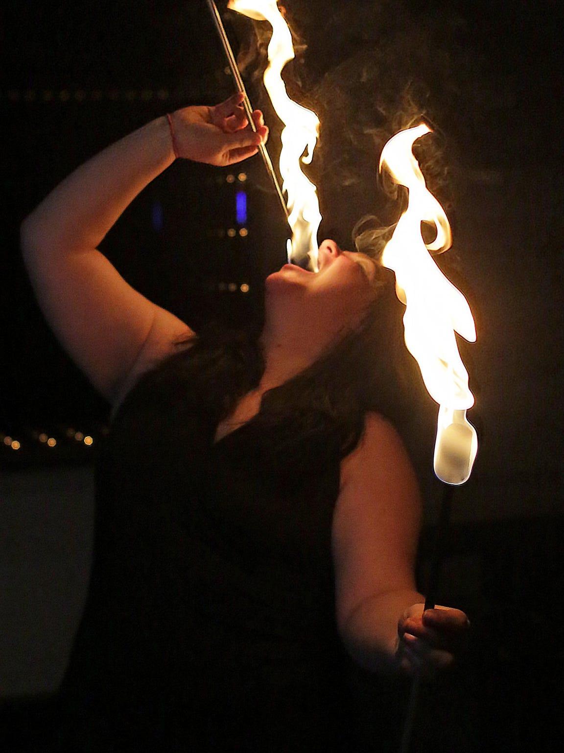Valerie Ringwell of Sheboygan, swallows a fire baton