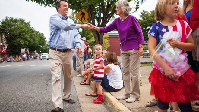 Del. Ben Cline, R-24th, shakes hands with people lining Magnolia Street during the 45th annual Buena Vista Labor Day parade on Monday, Sept. 7, 2015.